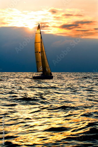Sports yacht in the sea at sunset. - 74552863