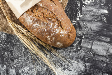 black bread with ears of wheat