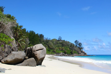 White beach and granite rocks by the sea on Seychelles