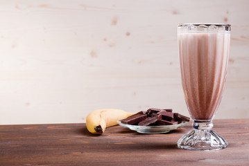 banana chocolate cocktail behind bananas and chocolate
