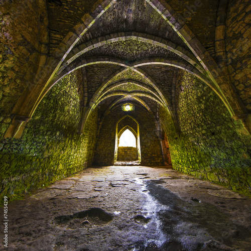 Leinwanddruck Bild Ancient medieval room with arches