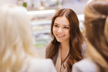 smiling young women meeting and talking