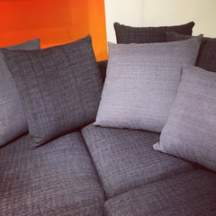Gray sofa with lots of cushions
