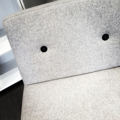 Close-up of modern white armchair