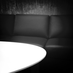 Black leather sofa and white table