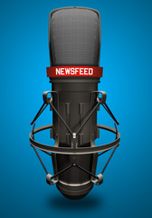 Microfono con scritta newsfeed