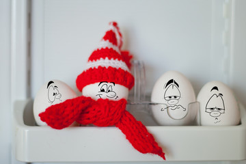 eggs in a funny hat with a cartoons face painted