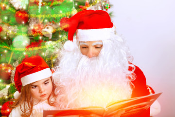 Santa Claus with cute granddaughter