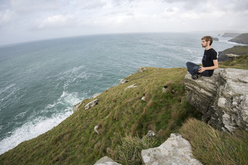 Sitting on the edge of Grass Hill cliff