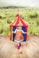 Little girl getting out of the tent