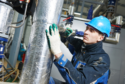 industrial worker at insulation work - 74556864