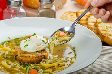 Beef broth with toast and egg benedict