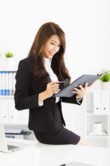 beautiful young business woman working with  in office