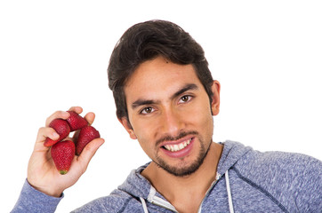 closeup portrait young man holding red strawberries