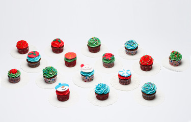 Lot of tasty cupcakes with sprinkles, chocolate