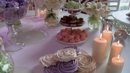 Dessert table richly decorated with flowers