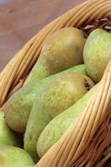 Few pears in a basket.