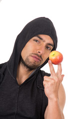 handsome young man holding red apple
