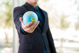 Fototapety Businessman with a globe