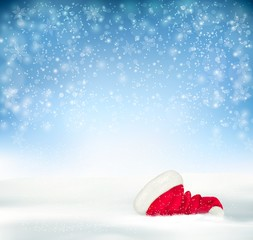 Blue Holiday Christmas background with santa hat, snow and snowf