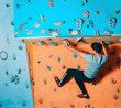 Man climbing up on practice wall