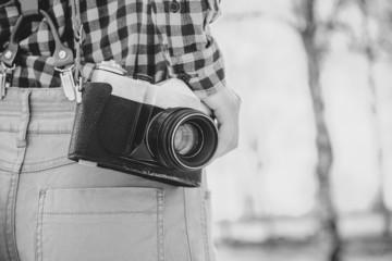 Old photo camera. Black-white photo.