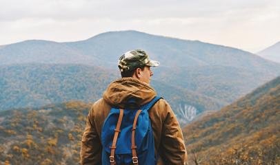 Traveler man enjoying by scenics in autumn season