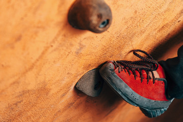 Female foot on climbing wall