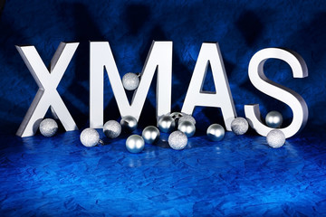 xmas letters with decorations on blue background