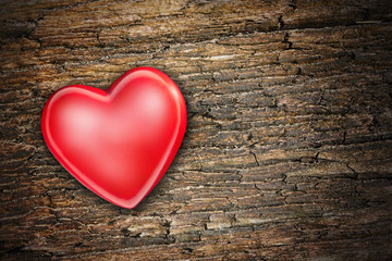 red heart on old shabby wooden background