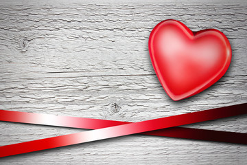 red heart on old wooden background