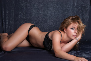 Beautiful girl wearing provocative black lingerie