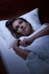 Woman suffering from sleeplessness