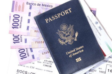 Travel documents and pesos