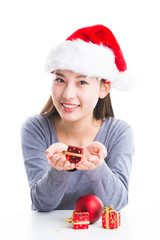 Young asian woman holding Christmas decorations in the hands.