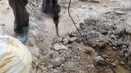 Using Jackhammer On A Rock