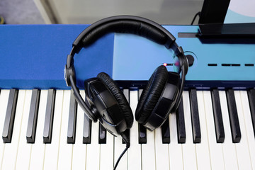synthesizer and headphones