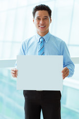 Businessman with empty placard