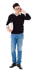 Full length portrait of  young man holding books