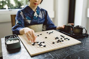 Playing wei qi game