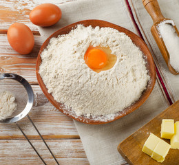 Baking ingredients - eggs, flour,  butter and sugar