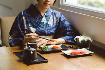 Eating nigiri sushi