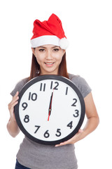 Asian girl with red santa hat and clock
