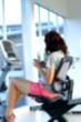 Blurred woman exercising smart phone.