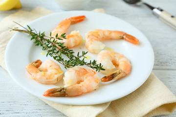 Shrimp and thyme on plate