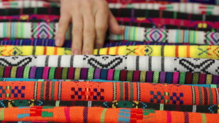 Woman Choosing Traditional Mexican Fabric