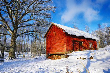 old farm and barn in a snowy winter landscape