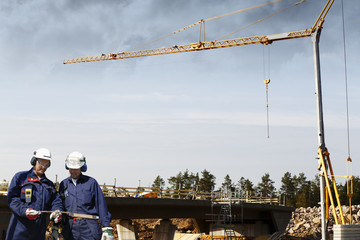 bridge construction, machinery and workers