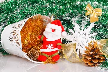 Santa Claus with white bucket, bumps and white snowflake