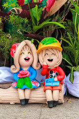 Boy and Girl Clay dolls for garden decoration